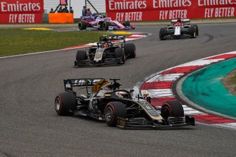 Romain Grosjean, Haas F1 Team VF-19, leads Kevin Magnussen, Haas F1 Team VF-19, and Kimi Raikkonen, Alfa Romeo Racing C38