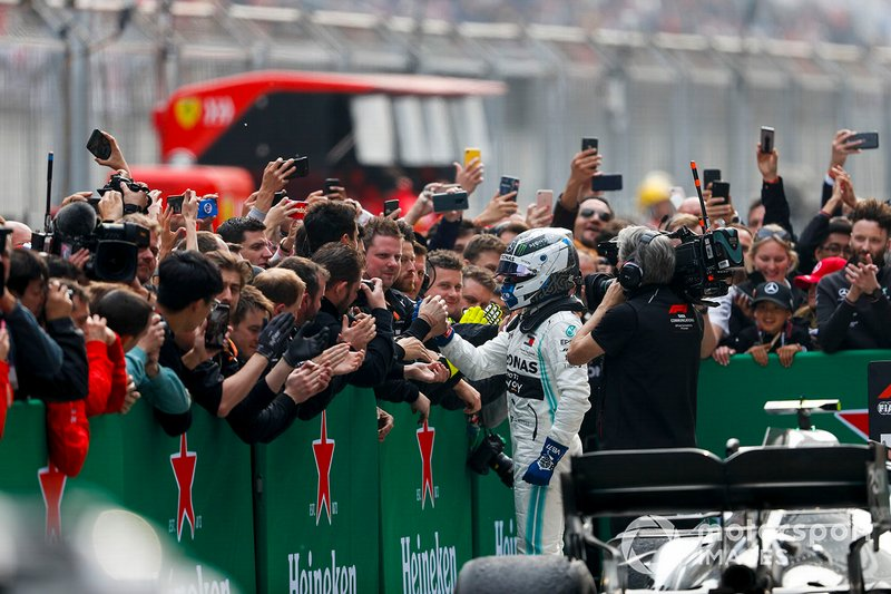 Valtteri Bottas, Mercedes AMG F1, 2nd position, celebrates with his team in Parc Ferme