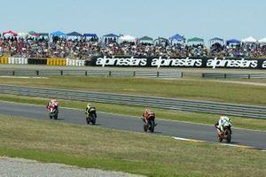Roberto Locatelli, Aprilia; Andrea Dovizioso, Honda; Casey Stoner, KTM; Pablo Nieto, Aprilia