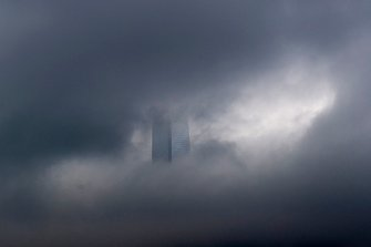 The Hong Kong skyline obscured by rain clouds