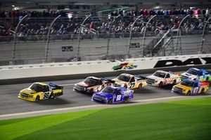 Grant Enfinger, ThorSport Racing, Ford F-150, Clay Greenfield, Clay Greenfield Motorsports, Chevrolet Silverado, and Todd Gilliland, Kyle Busch Motorsports, Toyota Tundra JBL lead a pack of trucks