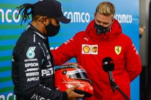Mick Schumacher presents Lewis Hamilton, Mercedes-AMG F1, 1st position, with his fathers helmet to commemorate his equal race win record of 91