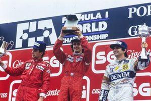Podium: Race winner Alain Prost, McLaren, second place Gerhard Berger, Ferrari , third place Nelson Piquet, Williams