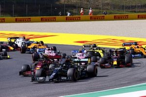 Lewis Hamilton, Mercedes F1 W11, Charles Leclerc, Ferrari SF1000, Alex Albon, Red Bull Racing RB16, Lance Stroll, Racing Point RP20, and the rest of the field at the start