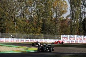 Lewis Hamilton, Mercedes F1 W11, Romain Grosjean, Haas VF-20, and Sebastian Vettel, Ferrari SF1000