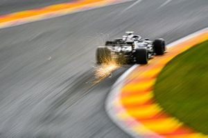 Sparks fly from the car of Valtteri Bottas, Mercedes F1 W11