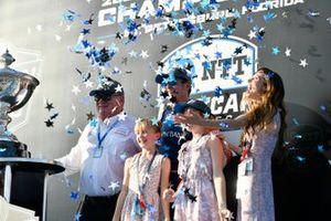 Scott Dixon, Chip Ganassi Racing Honda,, with wife Emma and daughters Poppy and Tilly, and team owner Chip Ganassi.
