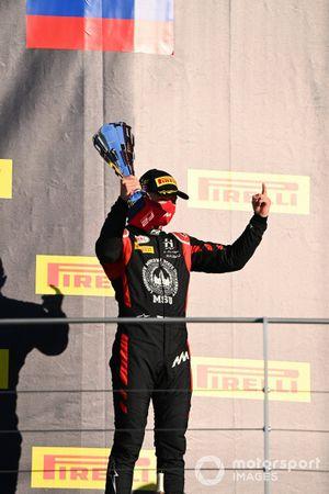 Nikita Mazepin, Hitech Grand Prix, with his trophy on the podium