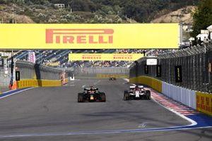 Max Verstappen, Red Bull Racing RB16 and Kimi Raikkonen, Alfa Romeo Racing C39