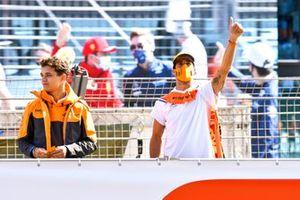 Lando Norris, McLaren and Daniel Ricciardo, McLaren wave to fans on the drivers parade