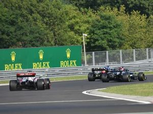 Fernando Alonso, Alpine A521, battles with Lewis Hamilton, Mercedes W12, ahead of Kimi Raikkonen, Alfa Romeo Racing C41