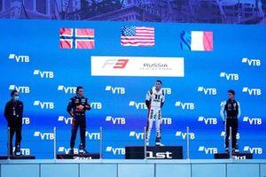 Podium: Race winner Logan Sargeant, Charouz Racing, second place Dennis Hauger, Prema Racing, third place Victor Martins, MP Motorsport