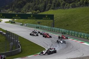 Kevin Magnussen, Haas VF-20, leads Daniil Kvyat, AlphaTauri AT01, as Charles Leclerc, Ferrari SF1000, and Sebastian Vettel, Ferrari SF1000, collide on the opening lap