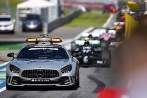 The Safety Car leads Valtteri Bottas, Mercedes F1 W11 EQ Performance, in the pit lane