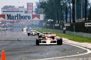 Alain Prost, McLaren MP4-4 Honda, leads Philippe Streiff, AGS JH23 Ford