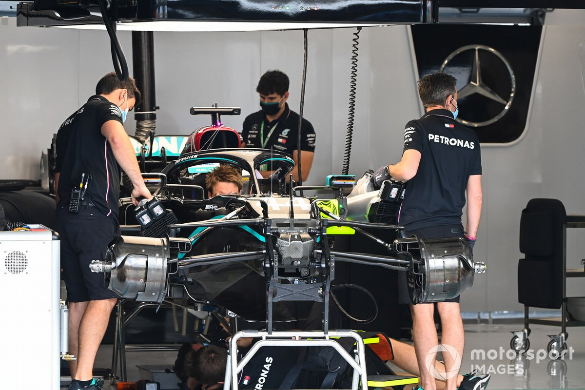 Mercedes mechanics at work in the team's garage