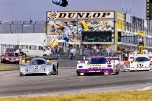 Michael Schumacher, Jochen Mass, Mercedes-Benz C11, passes Jan Lammers, Andy Wallace, Jaguar XJR-11