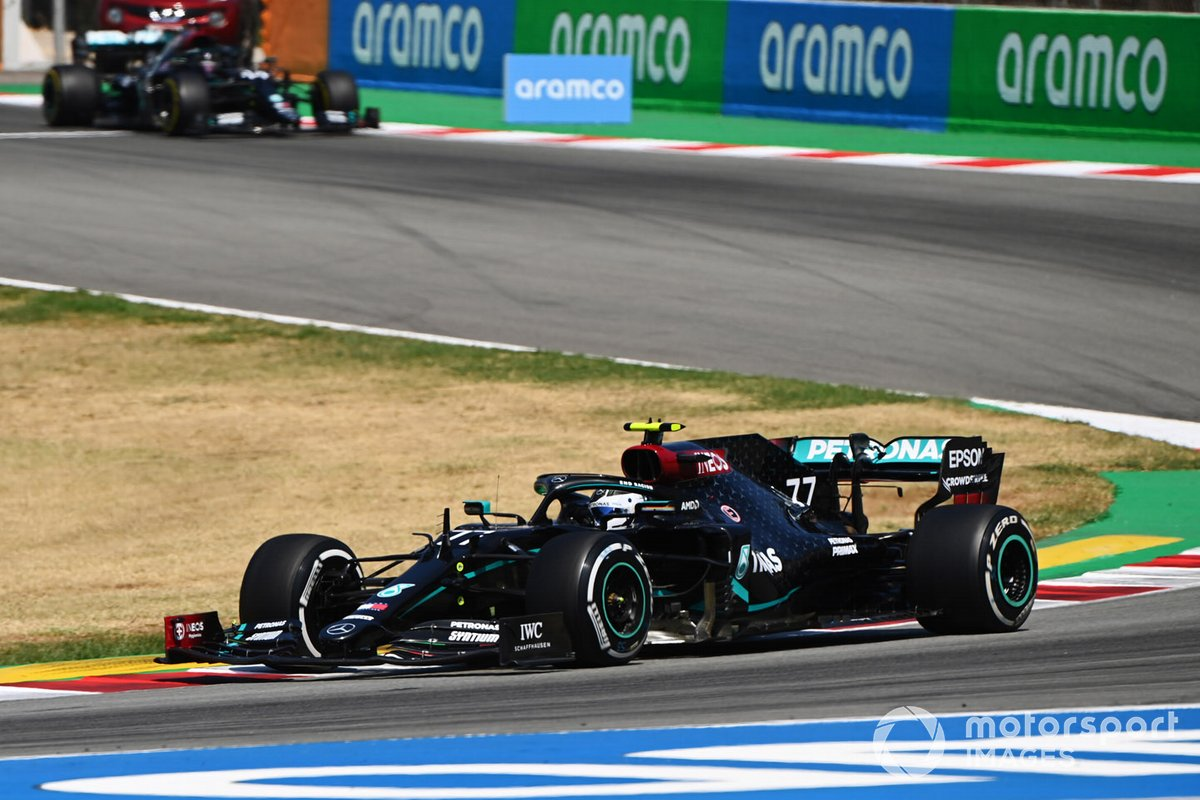 Valtteri Bottas, Mercedes F1 W11 EQ Performance, leads Lewis Hamilton, Mercedes F1 W11 EQ Performance