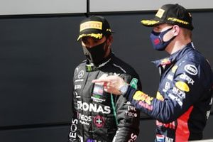 Lewis Hamilton, Mercedes-AMG F1, 1st position, and Max Verstappen, Red Bull Racing, 2nd position, talk after the race