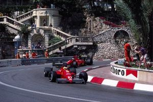 Michele Alboreto, Ferrari F1-87, leads teammate Gerhard Berger at Loews hairpin