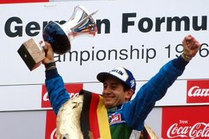 Race winner Jarno Trulli, celebrates on the podium