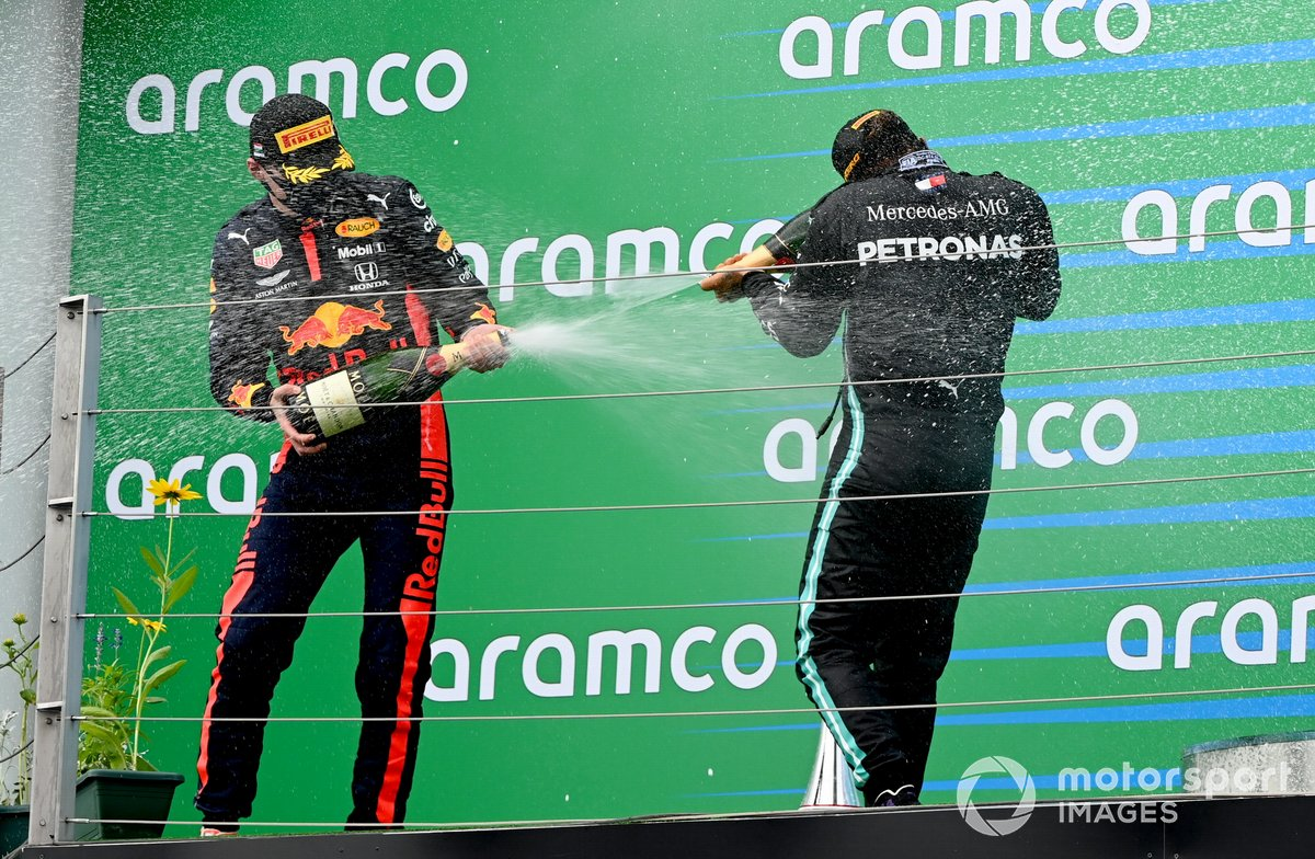 Max Verstappen, Red Bull Racing, 2nd position, and Lewis Hamilton, Mercedes-AMG Petronas F1, 1st position, on the podium