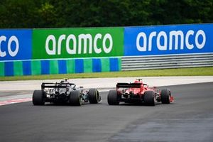 Charles Leclerc, Ferrari SF1000, passes Valtteri Bottas, Mercedes F1 W11