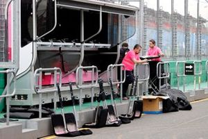 Racing Point personnel pack away their equipment on the pitwall