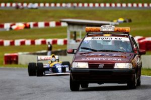 The Fiat Tempra 16V Safety Car leads Damon Hill, Williams FW15C Renault