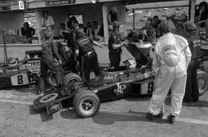 Mechanics work on Emerson Fittipaldi and Dave Walker's Lotus 72D Ford cars