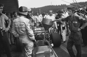 Emerson Fittipaldi, Lotus 49C-Ford, waits to be refuelled in the pits