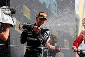 Lewis Hamilton, Mercedes, 1st position, sprays Champagne on the podium