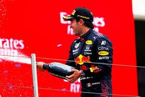 Sergio Perez, Red Bull Racing, 3rd position, sprays Champagne on the podium