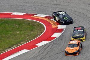 Daniel Hemric, Joe Gibbs Racing, Toyota Supra Poppy Bank and Riley Herbst, Stewart-Haas Racing, Ford Mustang Monster Energy