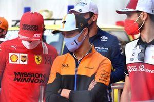 Carlos Sainz Jr., Ferrari, Lando Norris, McLaren, and Antonio Giovinazzi, Alfa Romeo Racing, in the drivers parade