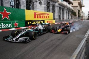 Max Verstappen, Red Bull Racing RB15, makes contact with leader Lewis Hamilton, Mercedes AMG F1 W10