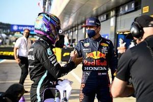 Pole man Lewis Hamilton, Mercedes, and Max Verstappen, Red Bull Racing, talk in Parc Ferme