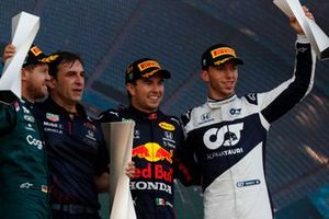 Sebastian Vettel, Aston Martin, 2nd position, the Red Bull trophy delegate, Sergio Perez, Red Bull Racing, 1st position, and Pierre Gasly, AlphaTauri, 3rd position, on the podium