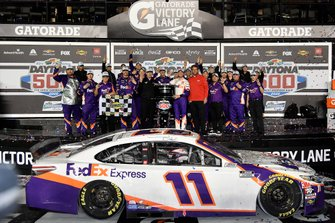 Denny Hamlin, Joe Gibbs Racing, Toyota Camry FedEx Express, celebrates in victory Lane after winning the Daytona 500.