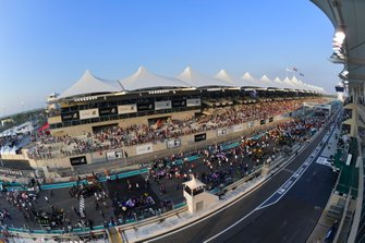 A scenic view of personnel and cars on the grid