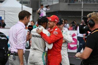 Jenson Button, Sky Sports F1, interviews Lewis Hamilton, Mercedes AMG F1, 1st position, and Sebastian Vettel, Ferrari, 2nd position, after the race