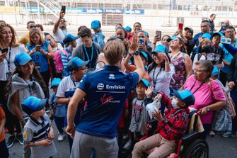 Sam Bird, Virgin Racing meets children in the pit lane duting the community tour