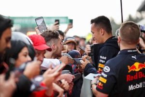 Alex Albon, Red Bull Racing signs an autograph for a fan