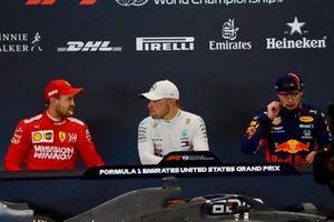 Sebastian Vettel, Ferrari, pole man Valtteri Bottas, Mercedes AMG F1, and Max Verstappen, Red Bull Racing, in the post Qualifying Press Conference
