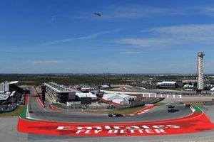Kimi Raikkonen, Alfa Romeo Racing C38, leads Nico Hulkenberg, Renault F1 Team R.S. 19, Daniil Kvyat, Toro Rosso STR14, and Romain Grosjean, Haas F1 Team VF-19