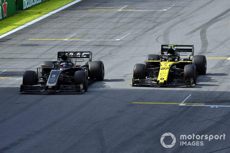Romain Grosjean, Haas F1 Team VF-19, battles with Nico Hulkenberg, Renault F1 Team R.S. 19