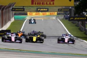 Lance Stroll, Racing Point RP19, battles with Daniel Ricciardo, Renault F1 Team R.S.19, and Sergio Perez, Racing Point RP19