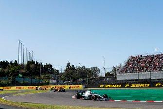 Lewis Hamilton, Mercedes AMG F1 W10, leads Carlos Sainz Jr., McLaren MCL34, Lando Norris, McLaren MCL34, and Alex Albon, Red Bull RB15