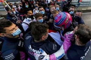 Lance Stroll, Racing Point, celebrates with his team after taking pole position