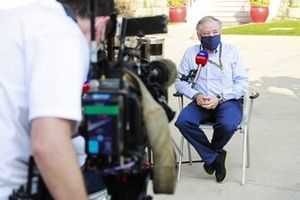 Jean Todt, President, FIA, is interviewed by Sky TV's Craig Slater in the paddock